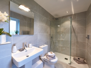 Fully tiled Laufen bathroom at Stocksmead