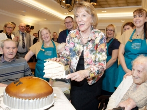 Esther Rantzen enjoyed a slice of cake with the residents and staff at the opening.