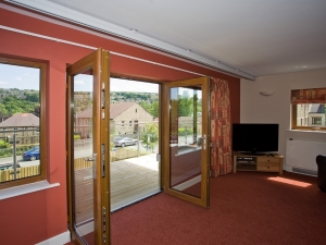 The living rooms have fantastic views across the Holme Valley.