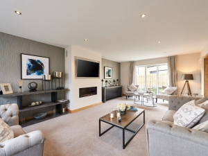 Spacious living room with full height windows to the garden at Stocksmead